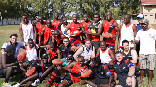 Aboriginal Boys with Mazambique AFL Team