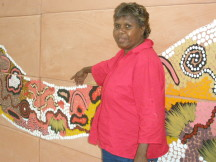 Gabriella Possum discussing her painting, Grandmother's Country- Bush Tucker Dreaming.