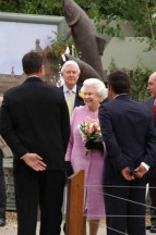 Queen Elizabeth at the Australian display at the Chelsea Flower Show where she accepted the Gabriella Possum painting that Aranda commissioned.